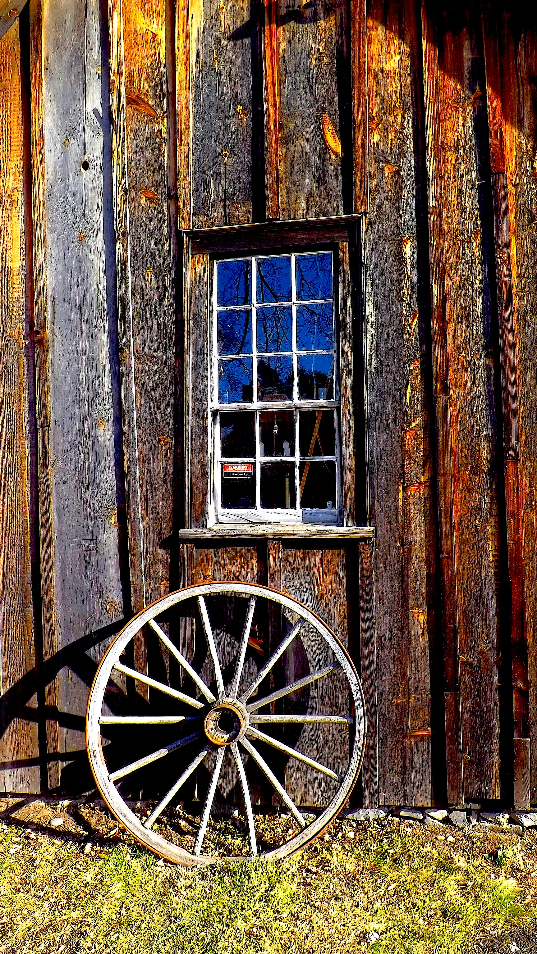 WAGON WHEEL AND WINDOW